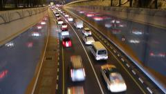 Night dense traffic at underpass exit, time lapse, crowded driveway, cars gather Stock Footage
