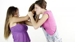 Two girls teenager fighting hitting each other pulling long hair isolated Stock Footage