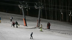 Skiers and snowboarders on a ski lift Stock Footage