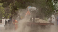 Workers repair road 1 Stock Footage