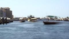 Abra ferry scurry around Dubai Creek, telephoto view, timelapse shot at day time Stock Footage