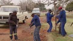 Workers erecting a fence Stock Footage