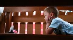 Little child boy watch cartoon via smart phone display Stock Footage