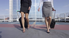4K Beautiful businesswomen traveling - walking with luggage at airport car park Stock Footage