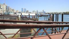 Abra ferry boat pier, time lapse, people come to land on gangway, daytime Stock Footage