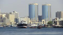 Dubai Creek waters busy with boat traffic at day, time lapse, telephoto view Stock Footage