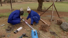 Workers erecting a fence 3 Stock Footage