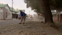 Workers repair road 2 Stock Footage
