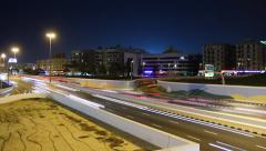 Recessed roadway at city junction, bustling traffic at night, time lapse Stock Footage
