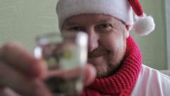 cheerful man in a Santa hat - stock footage