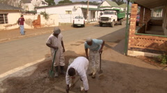 Workers repair road 6 Stock Footage