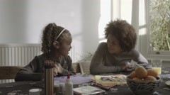 Parents with daughter drawing in living room Stock Footage
