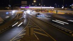 Road split after interchange, exit lane, night traffic, time lapse shot. - stock footage