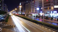 Very fast traffic move at night city street, perspective time lapse shot Stock Footage