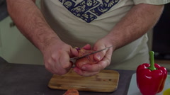Peeling a red onion Stock Footage