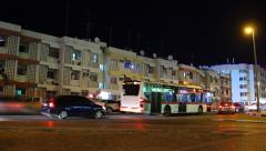 Dense night traffic at local quarter road, cars and buses time lapse Stock Footage