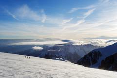 Ski tourer on Mont Blanc and Mont Blanc du Tacul, 4248m, behind, Chamonix, Rhone Stock Photos