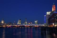St. Paul's Cathedral, Blackfriars Bridge and River Thames at dusk, taken from - stock photo
