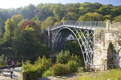 Worlds first iron bridge spans the banks of the River Severn in autumn sunshine, Stock Photos