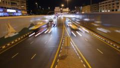 Quick night traffic at lowered road, time lapse shot. Driveway split Stock Footage