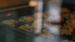 Cookies on a baking tray in the oven close up, Pan shot Stock Footage