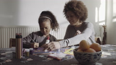 Parents with daughter drawing in living room - stock footage