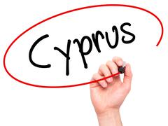 Man Hand writing Cyprus with black marker on visual screen Stock Photos