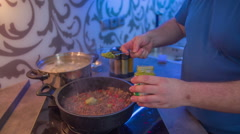Putting a green sauce into a pan Stock Footage