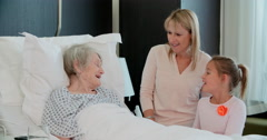 Family Visit To Grandmother In Hospital Bed Stock Footage