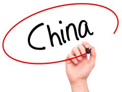 Man Hand writing China with black marker on visual screen - stock photo