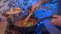Preparing a dish with meat and vegetables Stock Footage