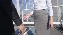 4K Beautiful businesswoman meet & shake hands in urban outdoor area - stock footage