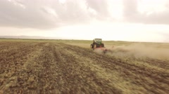 Aerial Footage Agriculture Tractor Ploughing Field Cultivation Dirt Equipment - stock footage