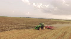 Drone Footage Tractor Ploughing Field Nature Scenic Agriculture Cultivation Dirt - stock footage