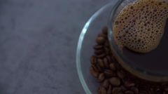 Coffee is in a cup on a kitchen counter Stock Footage