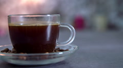 A cup of coffee is on a kitchen counter Stock Footage