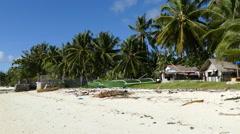 Catamaran Boats and houses at Anda beach Stock Footage