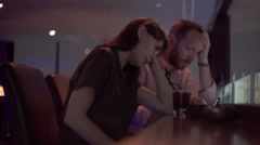 Young couple fighting, arguing in bar at night Stock Footage