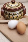 Bulgarian traditional crock with wooden spoon - stock photo