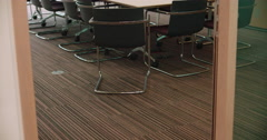 An empty office meeting room and conference table Stock Footage