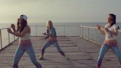 Talented energetic girl dancing twerk in sunset by the sea Stock Footage