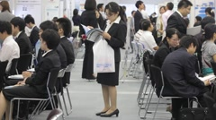 Crowd of college students attend a job/career fair in Tokyo  Japan Stock Footage