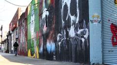 Wide shot of a street filled with graffiti street Bushwick Brooklyn New York Stock Footage