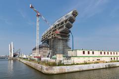 Construction site of modern new port office in harbor of Antwerp, Belgium - stock photo