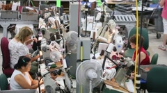 Overhead shot of Americans sewing at factory floor in U.S. Stock Footage