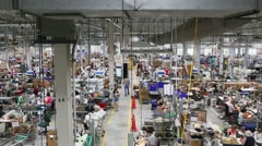 Wide overhead shot of Americans working at factory floor in U.S. Stock Footage