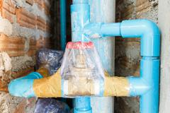 Tap water valve wrapped for cleanliness - stock photo