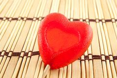 Valentine day concept - heart shaped lolly pop on wood background, copy space - stock photo