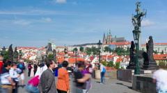 People walk on the Charles Bridge in Prague, timelapse Stock Footage
