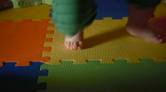 Close up Video of Caucasian Baby Boys feet under a Bouncy chair and Bouncing Stock Footage